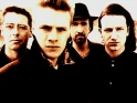 U2, zleva Adam Clayton, Larry Mullen Jr., The Edge, Bono, cca 1988
