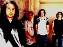 Rage Against The Machine, zleva Zack de la Rocha, Tom Morello, Timmy C., Brad Wilk, cca pol. 90. let