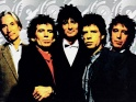 Rolling Stones (zleva Charlie Watts, Keith Richards, Ron Wood, Mick Jagger, Bill Wyman, 1989-90)