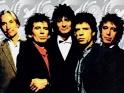 Rolling Stones (zleva Charlie Watts, Keith Richards, Ron Wood, Mick Jagger, Bill Wyman, 1989-90)